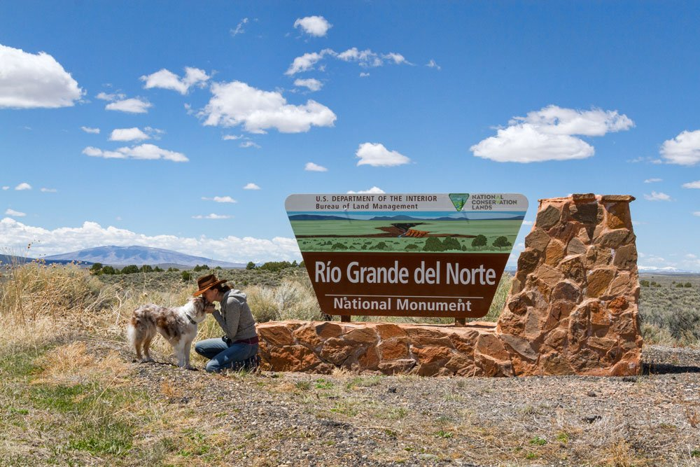 Iris and me in front of the Rio Grande del Norte entrance sign