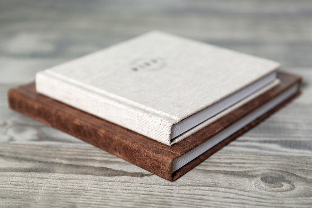 an example of an album with a linen cover and an album with a leather cover